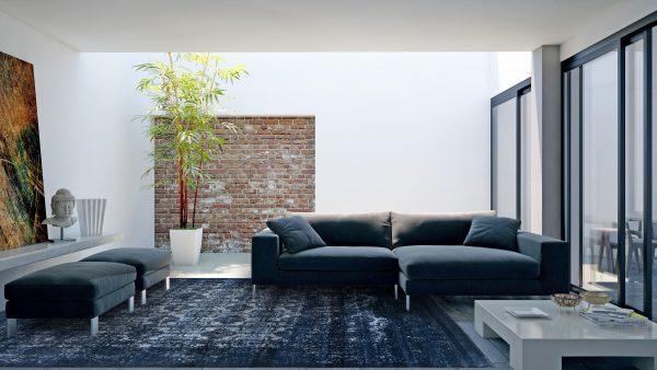 Moderner Raum mit dunkelblauem Teppich